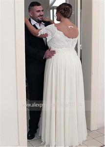 Image 2 - Unique Chiffon Jewel Neckline A line Plus Size Wedding Dresses With Beaded Lace Appliques Short Sleeves Bridal Gown