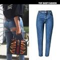Новые 2017 женщины высокой талией разорвал джинсы sexy хип сломленное отверстие джинсовые брюки женские карандаш тонкий узкие джинсы femme тай haute