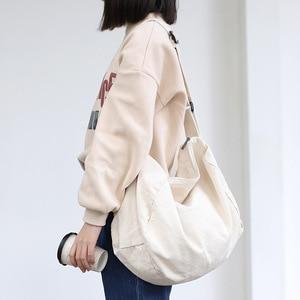 Image 1 - 女性のキャンバスのショルダーバッグ綿の布クロスボディバッグ固体ジッパーハンドバッグショッピングバッグトートバッグ学生エコシンプルなブックバッグ