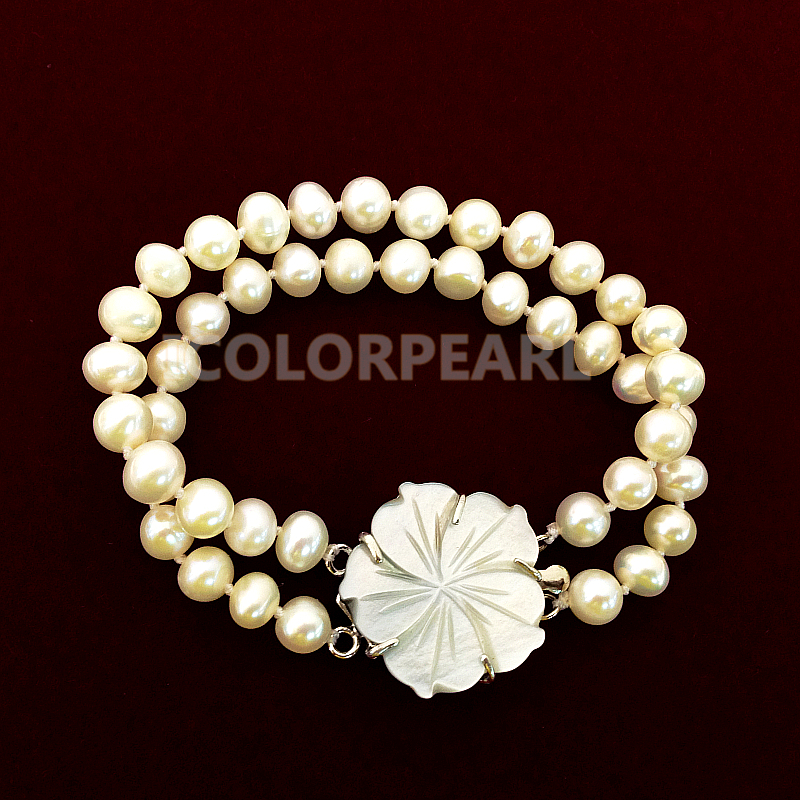 Two Strand 6 7mm White Natural Freshwater Pearl Bracelet With A Nice Shell Carving Clasp.
