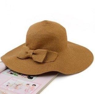 Novas Moda feminina Dobrável Aba Larga Floppy Summer Beach Straw Hat Cap  Borboleta Doce Frete Grátis em Chapéus de sol de Acessórios de vestuário no  ... 7b0f4afb79b