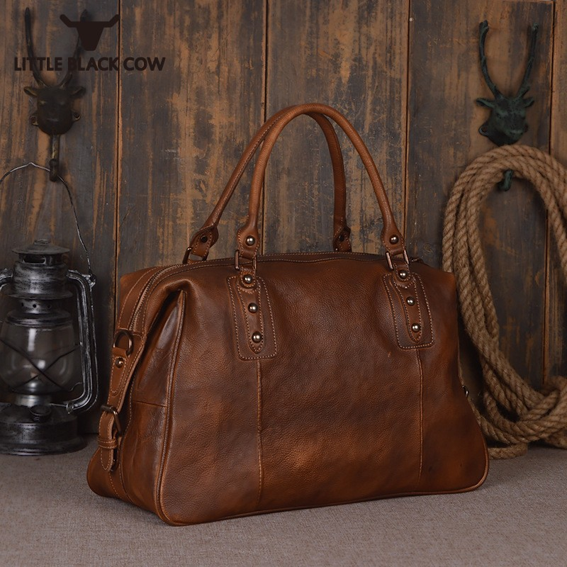 Famous Brand Woman Travel Bags Handmade Retro 100% Real Leather Tote Bags Unisex High Capacity Luxury Ladies Luggage HandbagsFamous Brand Woman Travel Bags Handmade Retro 100% Real Leather Tote Bags Unisex High Capacity Luxury Ladies Luggage Handbags