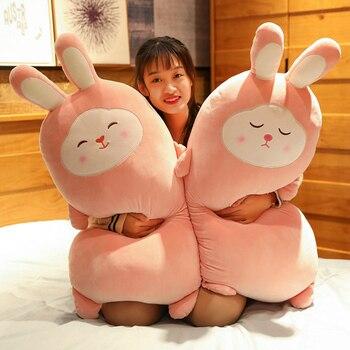 almohadas grandes con forma de conejo