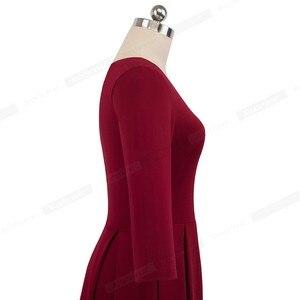 Image 5 - Güzel sonsuza kadar Vintage katı renk V yaka pin up cepler vestidos A Line iş parti kadın Flare salıncak kadın elbise A126