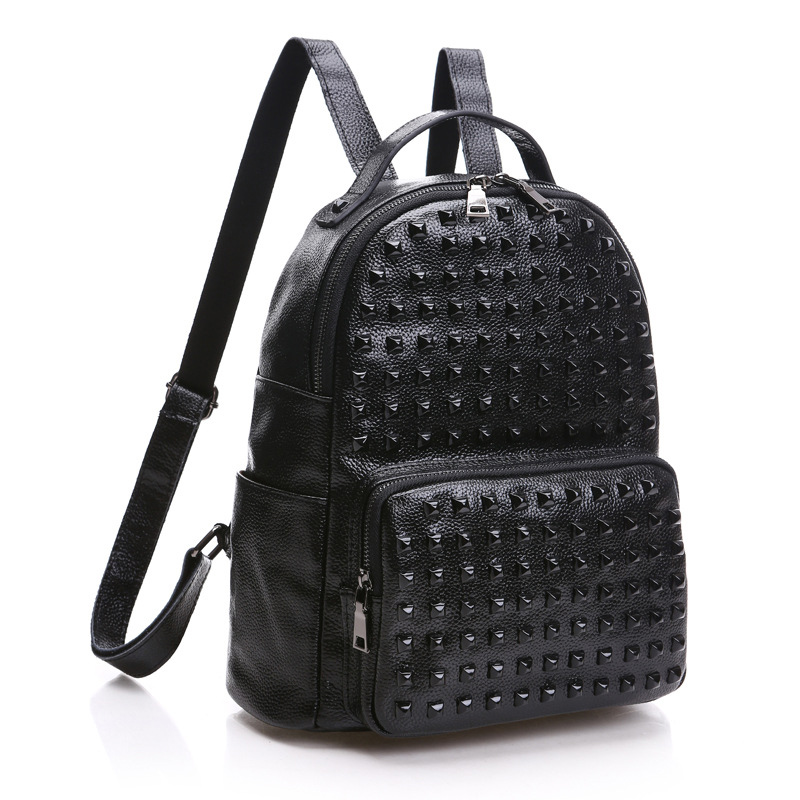 The new Korean version of the leather shoulder bag leather  backpack  fashion wholesale rivets the other side of the road new extended version cd
