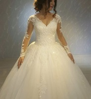 Romantic Sexy V Neck Ball Gown Wedding Dress 2018 Bride Dress Long Sleeves Lace Bridal Gown Beading Backless White Formal Dress