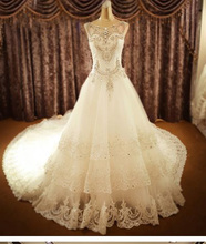 Luxury Royal Wedding Dress Sleeveless O-neck Ball Gown Vestido De Noiva Tiered Beading Crystal Cathedral Train NM 630