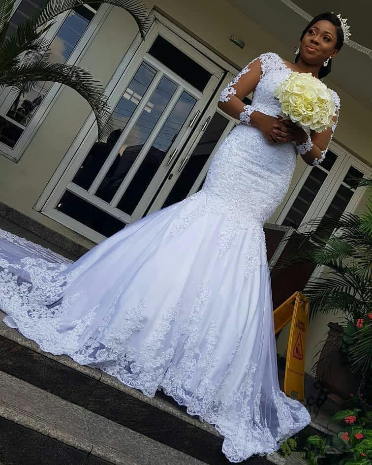 2020 Illusion Long Sleeves African Wedding Dresses Mermaid Lace Applique Trumpet Wedding Gowns Sweep Train Bridal Dresses