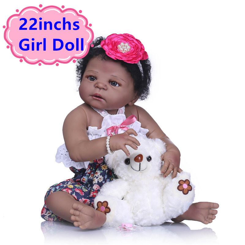 NPK 22 Inch Reborn Baby Girl Doll With Black Short Curl Hair Lifelike Reborn Baby Girl Doll In Fashion Dress For Girls GiftsNPK 22 Inch Reborn Baby Girl Doll With Black Short Curl Hair Lifelike Reborn Baby Girl Doll In Fashion Dress For Girls Gifts