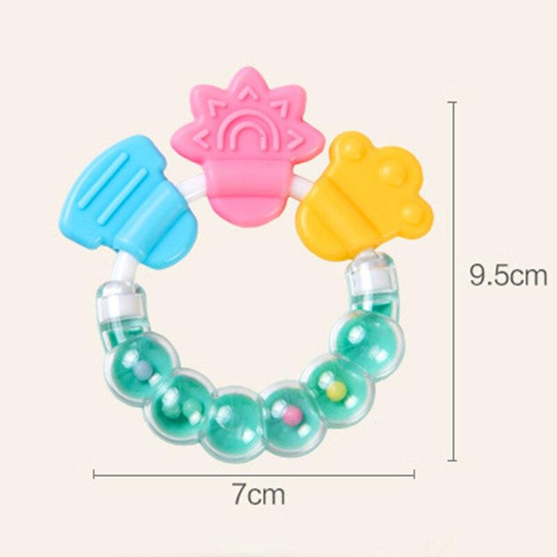 Купить с кэшбэком Cartoon Baby Teether Educational tools Chew Teeth Ring Biting Baby Rattle Toy Bed Bell Silicone Handbell Jingle Birthday Gifts