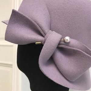 Image 5 - אלגנטי פורמליות נשים צמר כובע חם הרגיש חורף פדורה כובע פרל Bowknot הקלוש Bowler כובע גבירותיי המפלגה דרבי כנסיית חתונה כובע