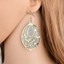 The new retro palace style multi-layered hollow earrings Ms. exaggerated frosted