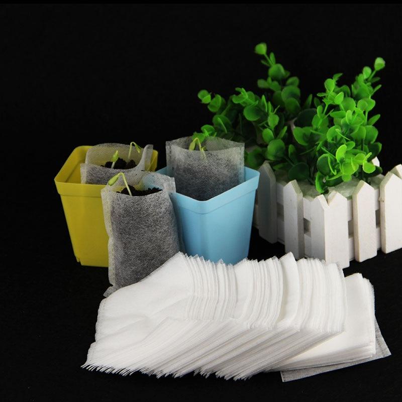 100 piezas de plántulas de plantas de vivero bolsas orgánica Biodegradable bolsas de crecimiento 8*10cm vivero ollas de la protección del medio ambiente suministros de jardín Bandeja de jardín de semillas de Hidroponia bandeja de semillero de doble capa