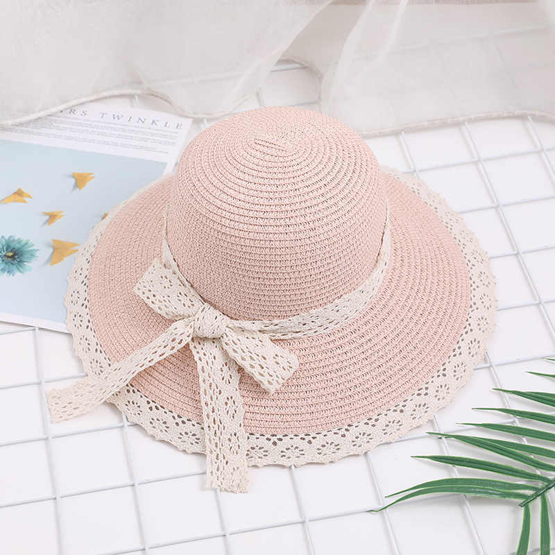 The new summer female Korean version of gauze bow hat outdoor travel fashion sun visor Beach Hat wholesale ponytail beanie