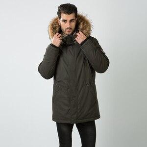 Image 2 - HERMZI abrigo de invierno de algodón acolchado para hombre, Parka gruesa de piel de mapache, Chaqueta larga acolchada, M 4XL de estilo ruso, 2020