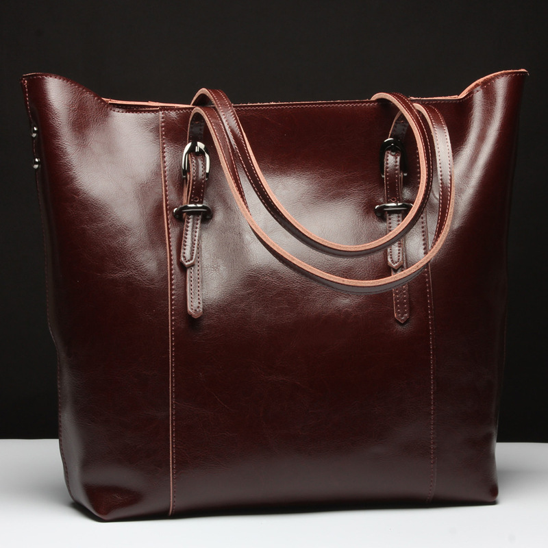 3664acc445 Aliexpress.com   Buy New Genuine Leather Handbags Women Cow Leather  Shoulder Bags Famous Brand Design Ladies Leather Tote Bag Female Messenger  Bag from ...