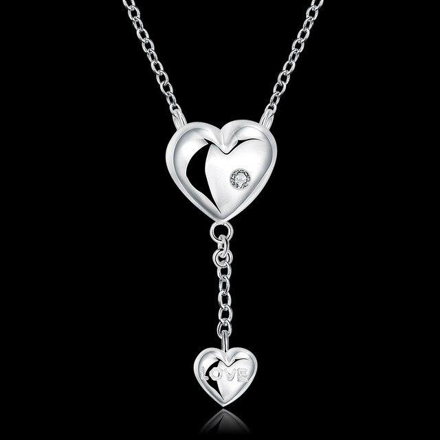 Фото женское ожерелье с кулоном в виде сердца кристаллами