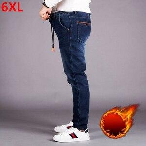 Image 1 - Elastische taille jeans männer plus dünger XL hohe taille elastische lose plus samt füße hosen herren hosen hosen winter