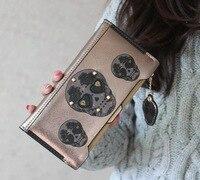 Nouveau Top Fasion Zipper 2014 marque femmes coréenne Punk crâne Kito Hit couleur Rivet portefeuilles Pu bourse en cuir portefeuille Coin cartes porte -