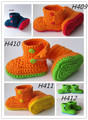 Zapatitos de bebé, botines del ganchillo, Zapatos de bebé, Botines infantiles, Zapatos del niño. de color naranja y verde