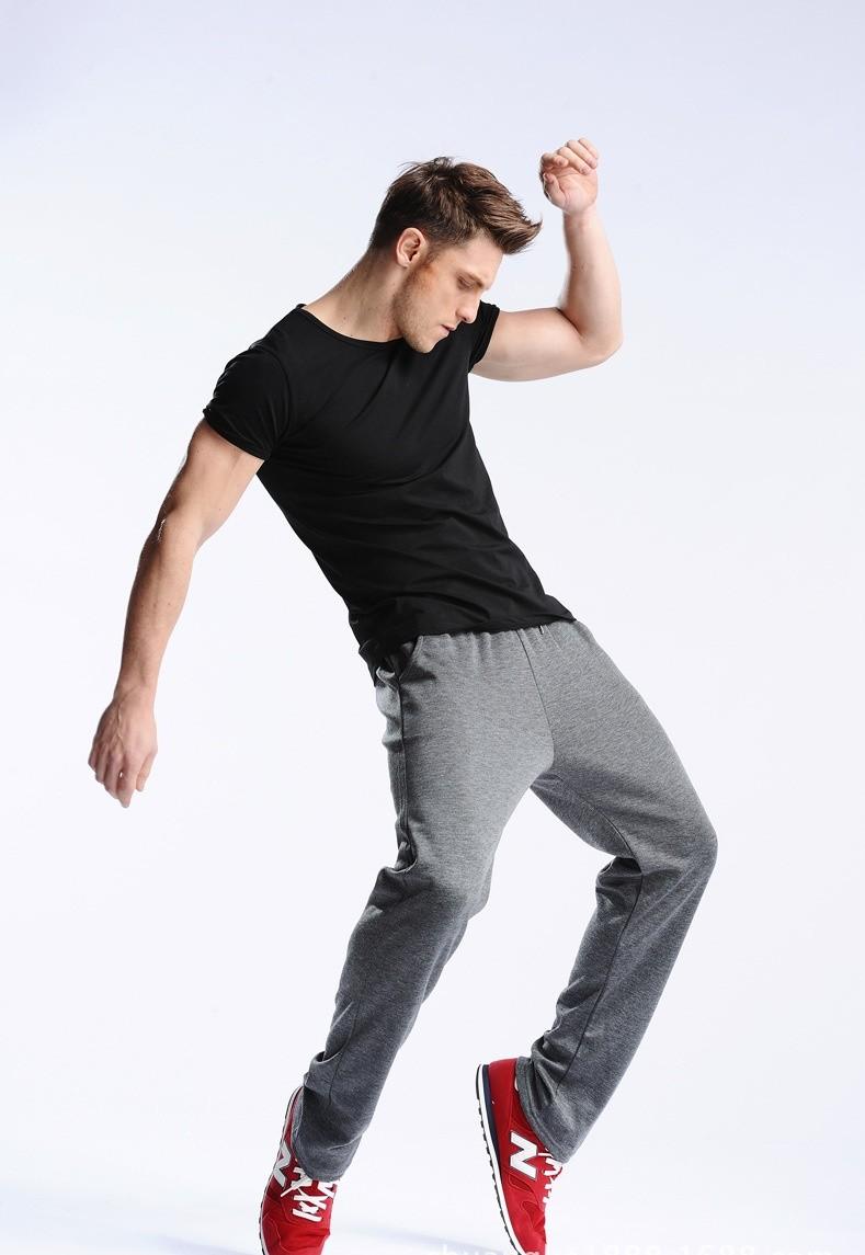 Uwback 17 Plus Size 4XL New Sweat Pants Men Joggers Pants Elastic Waist Loose Sweat Pants For Men Casual Trousers homme CAA329 8