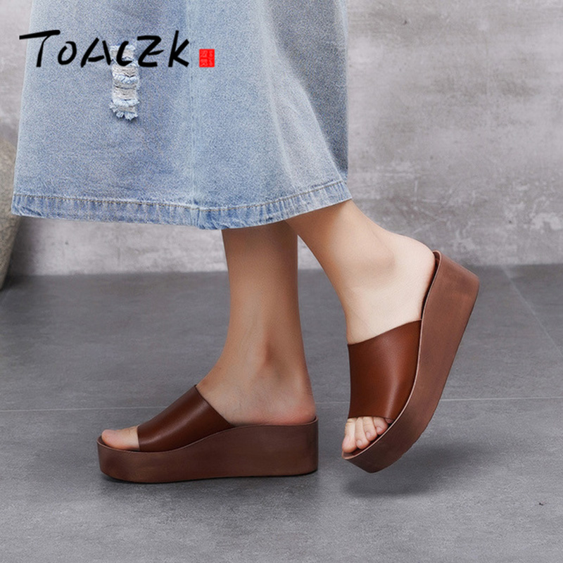 Spring and summer new slope heel thick bottom shoes feminine leather simple outdoor comfortable drag shoes