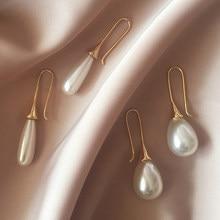 db900d82b013 Pendientes de perlas de simulación de lágrima blanca colgantes para mujeres  estilo barroco Palacio joyería largo temperamento ga.