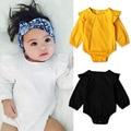 Ребенка комбинезон девочка твердые рюшами с длинным рукавом комбинезон новорожденный белый черный комбинезоны, ползунки для малышей техники одежда