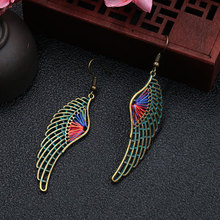 The new European and American fashion earrings contracted dazzle colour hollow out long wings ms popular adorn article