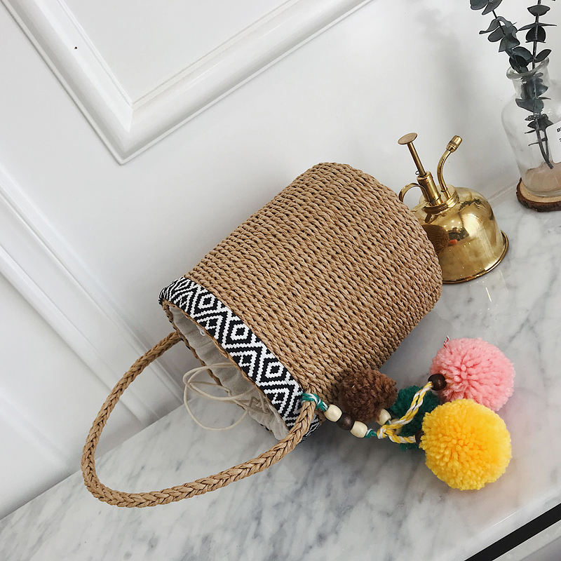 2019 new fashion portable bucket woven bag tote bag embroidery hair ball pendant straw bag summer vacation ladies beach bag in Top Handle Bags from Luggage Bags