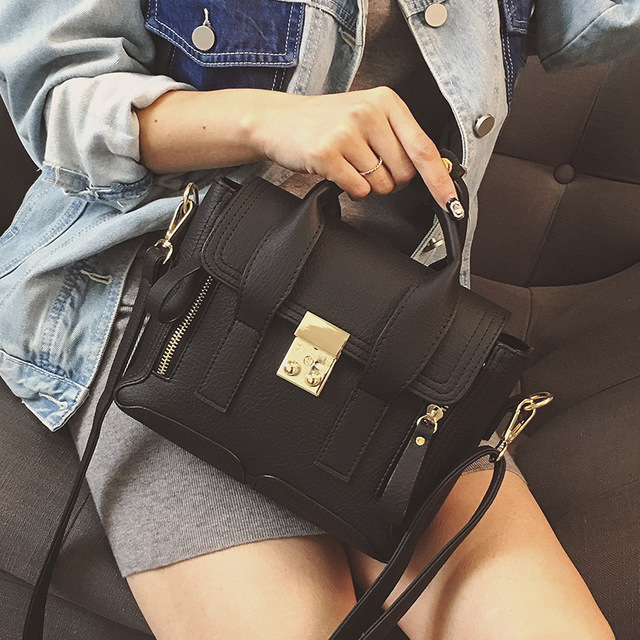 2016 New Autumn And Winter Fashion Zipper Lock Wings Simple Portable Shoulder Bag Messenger Bag Boston Women shoulder bags