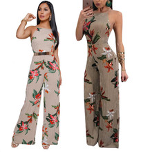 New summer Italian hot new wave Bohemian casual wrapped chest hanging neck hollow print loose sexy jumpsuit