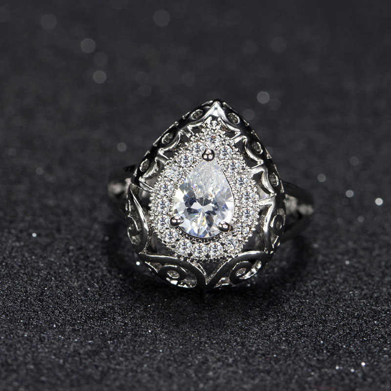 CWWZirconsสวิสCubic Z Irconiaตั้งน้ำหยดรูปร่างผู้หญิงแต่งงานหมั้นแหวนที่สร้างหินสีเขียวมรกตR085