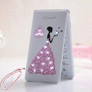 Image 1 - Флип 2,4 с сенсорным экраном и двумя SIM картами, в режиме ожидания, русский, французский, испанский, для женщин и девушек, милый светодиодный фонарик, мобильный телефон GSM