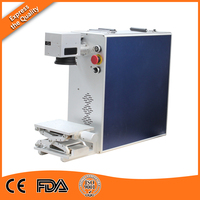 30 Watt fiber MOPA laser marking machine for stainless steel / ring / mobile phone case cover