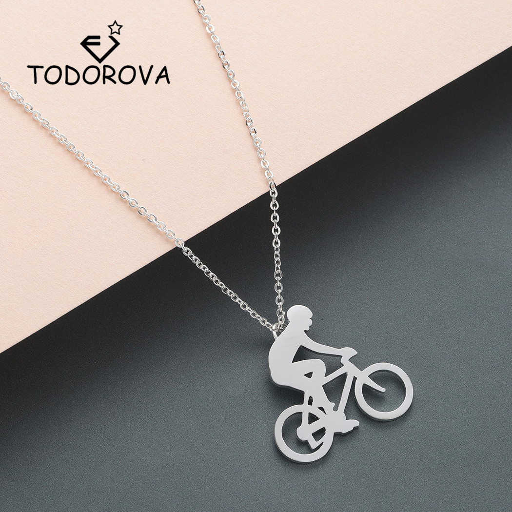 cycling sport 30mm x 23mm hobbies Silver coloured bicycle and hearts pendant