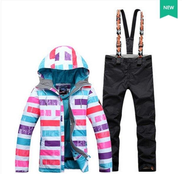 Prix pour Arc en ciel de femmes combinaison de ski féminin planche à roulettes ski ensemble vêtements de ski rose bleu violet rayures veste de ski et noir ski pantalon vêtements de ski