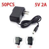 50 шт. преобразователя адаптер переменного тока к DC Мощность адаптер питания 100 В 240 В ЕС Plug DC 5 В 2A 2000mA 5,5 мм x 2,1 мм для Светодиодные ленты выключ