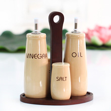 four-piece oil and vinegar bottles ceramic seasoning bottle set with wooden base herb and spice tools cooking tool