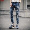 O novo 2017 buraco em jeans homens Elástico cultivar a moralidade calças pé patch
