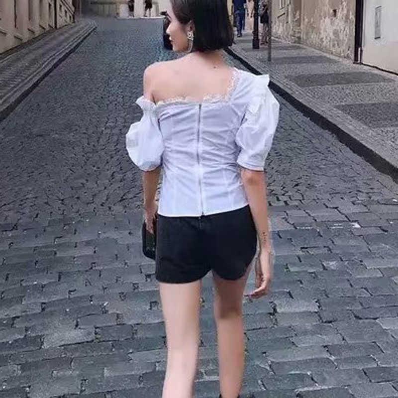 Style français femmes été Double dentelle une épaule manches courtes bouffantes haut T-shirt avant simple boutonnage bouton solide T-shirt