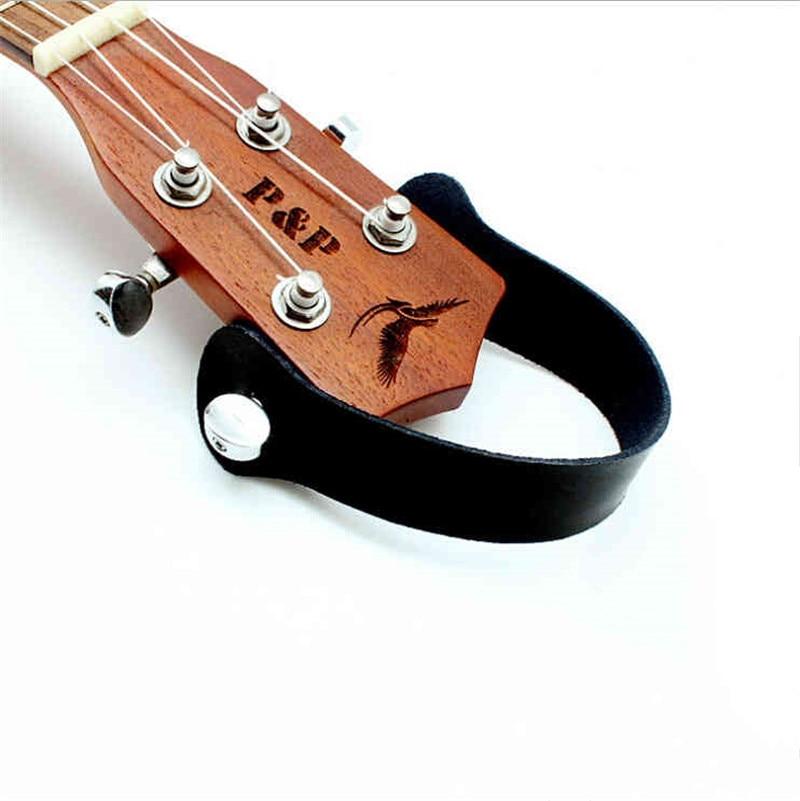 Pequeña Guitarra de Cuatro Cuerdas Ukulele Correas De Cuero Cordón Colgante Ganc