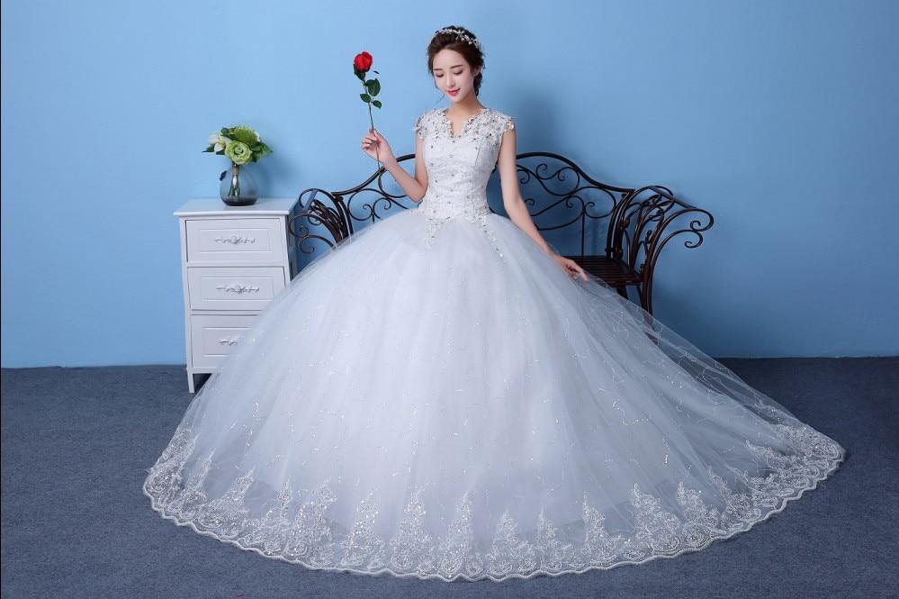 Vestido De Noiva New Design Ball Gown Lace Appliques Wedding Dresses 2019 V Neck Crystal Backless