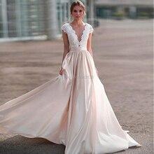 Szampan elegancka satynowa koronkowa aplikacja linia suknie ślubne Sexy Sheer z wycięciem z krótkimi rękawami ślubna suknia ślubna sąd pociąg