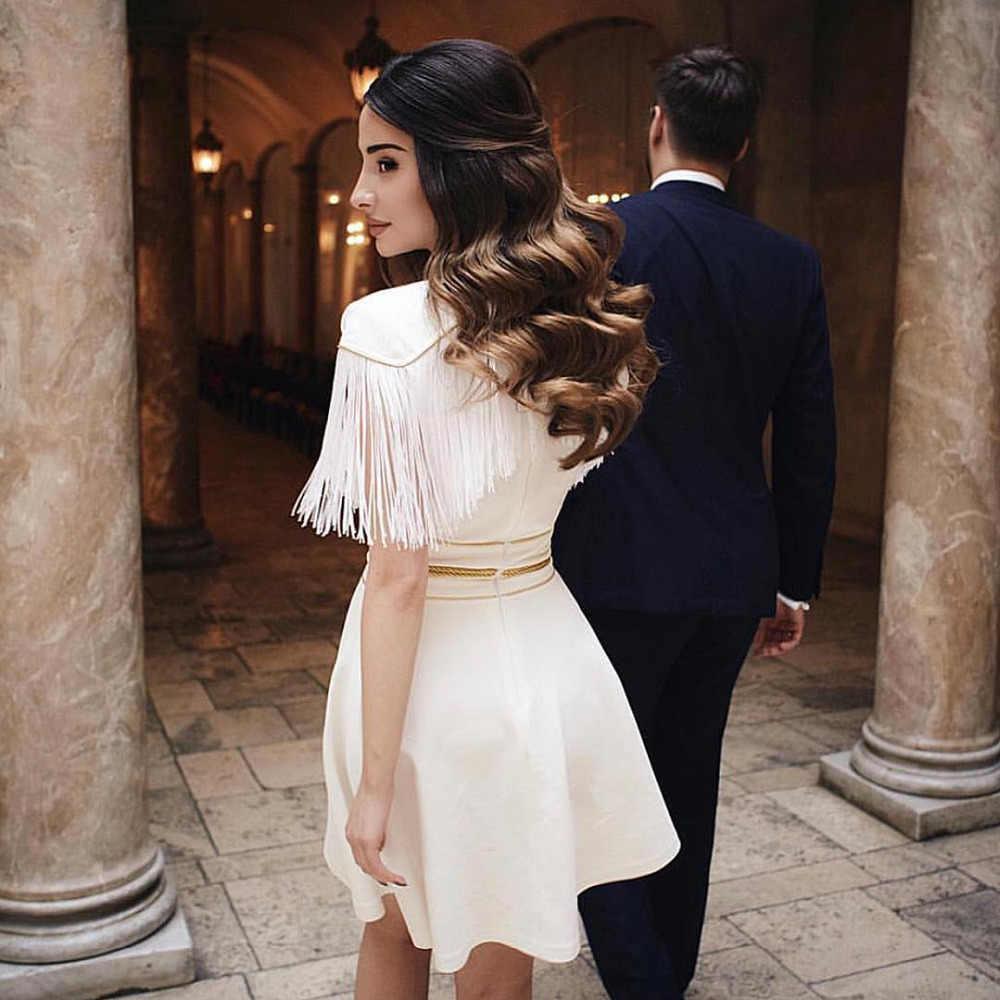 Cleezy 2018 nueva llegada blanco borla corto elegante Silm vendaje vestido verano otoño Bodycon Club Wear Vestidos HL4170