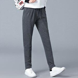 Image 2 - Grande taille lâche chaud Harem pantalon femmes automne hiver graisse femme velours épais pantalon décontracté pantalon de sport M 6XL