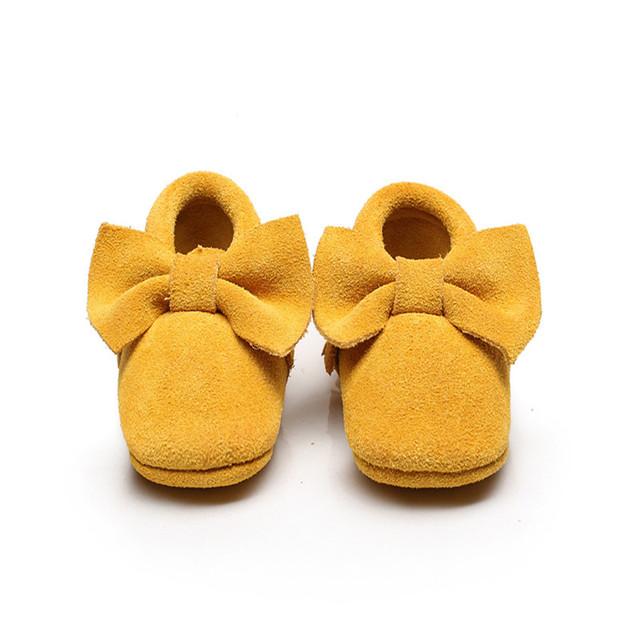 2016 Nueva Llegada de Cuero de Gamuza Suela Suave Baby Girl Bowknot Primeros Caminante Recién Nacido Bebé Infantil Prewalker de Los Zapatos Mocasines
