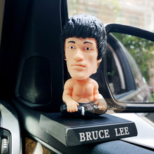 Chinese Kungfu superstar Bruce Lee car accessories cute head shaking doll cartoon mobile phone bracket
