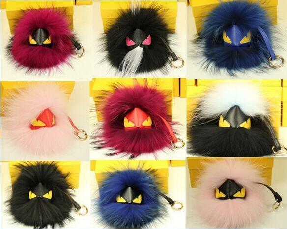 2016 new1pc Fashion handbag Black Leather Wallet Fur Pom Pom Real Fur Monster Doll Keychain Charm Cart Bag Bugs Pendant Strap