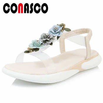 CONASCO 2019 Summer Round Toe Women Flats Sandals Rome Shallow Elastic Band Flowers Decoration Genuine Leather Basic Shoes Woman